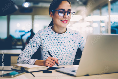 Smart young woman satisfied with learning language during online courses using n Canvas
