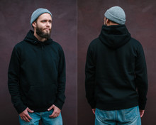 City Portrait Of Handsome Hipster Man With Beard Wearing Black Blank Hoodie Or Sweatshirt With Space For Your Logo Or Design. Front And Back View Mockup Of Black Hoodie