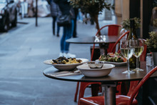 Food And Wine On The Outdoor Table Of A Restaurant, Selective Focus.