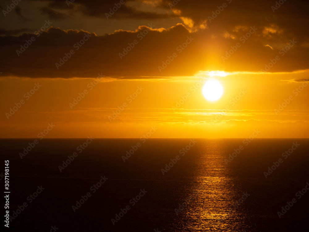 Orange sunset over Pacific Ocean from big island of Hawaii