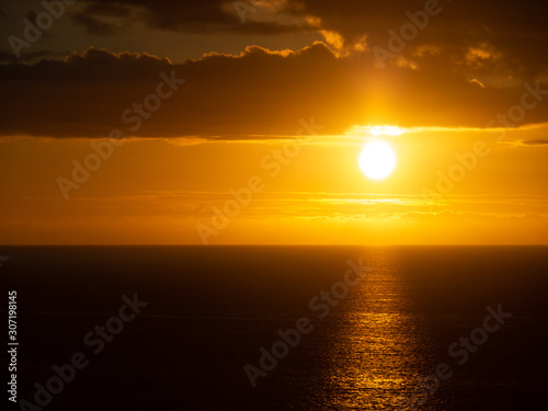 Orange sunset over Pacific Ocean from big island of Hawaii