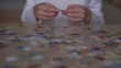 puzzle collected by hardworking girl teenager in white shirt sitting at table relaxing after lessons extreme close view