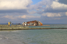 Rusty Ship Lying On Its Side O...