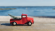 Christmas In Florida Theme, Red Toy Truck Hauls A Christmas Tat Lake Louisa State Park In Clermont, Florida.