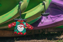 Santa's Ugly Sweater Hangs Off Kayaks In Lake Louisa, Clermont , Florida.