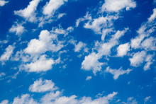 Puffy White Scattered Clouds A...