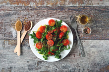 Healthy Salad With Arugula And Cherry Tomatoes With Mustard Sauce. Vegan Food.