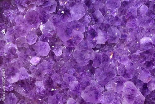 Photo Gemstones amethyst bright purple, texture of stone