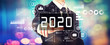 Leinwandbild Motiv 2020 New Year concept with a businessman on a shiny background