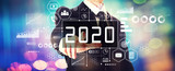 2020 New Year concept with a businessman on a shiny background