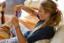 13 Year Old Girl Knitting On C...