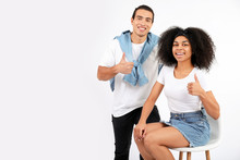 Portrait Of Stylish Young African-American Couple On White Background