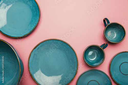 Fototapeta Set of clean dishes and cups on color background. obraz