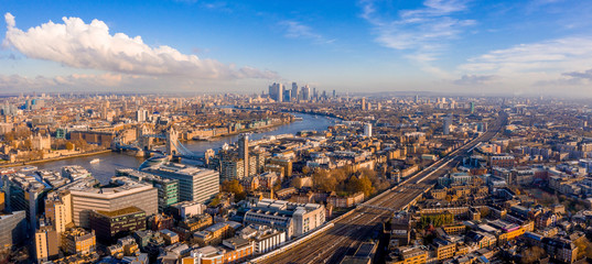 Panoramic aerial view of London, UK. Beautiful skyscrapers, river Thames and railway going through the city.