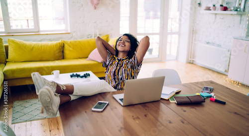 Smiling black student relaxing after working on laptop Canvas Print