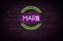A Green And Purple Neon Light Sign That Reads: MARS