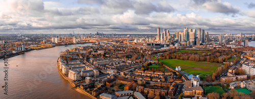 Poster de jardin Paris London, England - Aerial Panoramic skyline view of Bank and Canary Wharf, central London's leading financial districts with famous skyscrapers at golden hour sunset during cloudy skies.