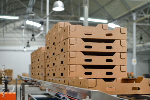 Stack of folded paper box in warehouse Fotobehang
