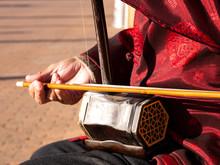 Asian Senior Man Playing An Er...