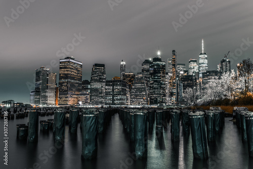 Long exposure of old dock and downtown Manhattan