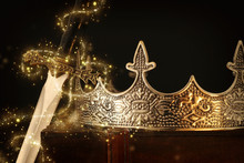 Low Key Image Of Beautiful Queen/king Crown Over Antique Box Next To Sword. Fantasy Medieval Period. Selective Focus. Glitter Sparkle Lights