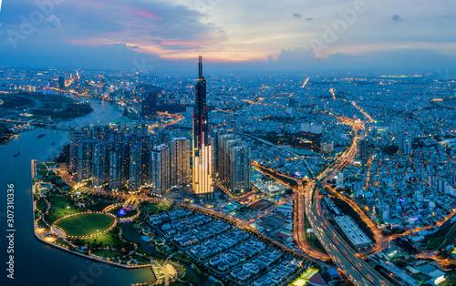 Aerial cityscape of Saigon at beautiful nightfall sky in evening