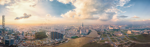 Leinwand Poster Panorama cityscape of Ho Chi Minh city under blue sky