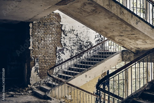 Beautiful view of the stairway in an old abandoned building