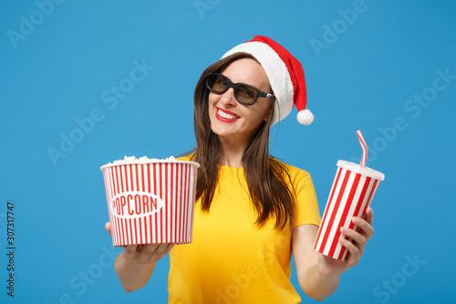 Smiling Santa girl in Christmas hat 3d imax glasses posing isolated on blue background Wallpaper Mural