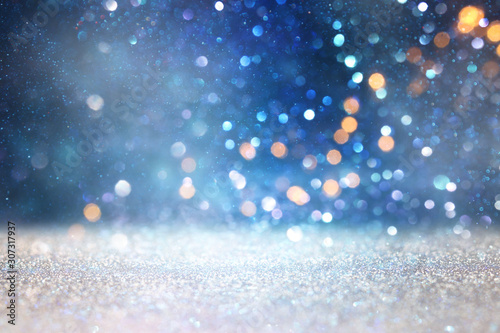 abstract glitter silver and blue lights background. de-focused