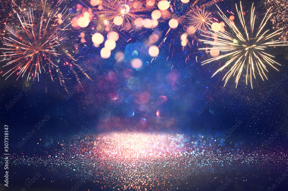 Fototapeta abstract gold, black and blue glitter background with fireworks. christmas eve, 4th of july holiday concept