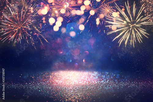Fototapeta abstract gold, black and blue glitter background with fireworks. christmas eve, 4th of july holiday concept obraz
