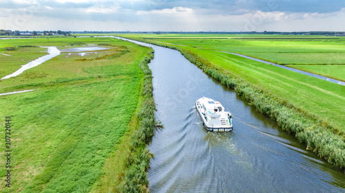 Aerial drone view of houseboat in canal and country landscape of Holland from ab Fototapeta