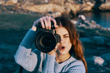 Young Woman Taking Photo With ...