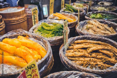 Fototapeta Various pickled vegetables at Nishiki market, Kyoto, Japan obraz