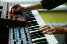 Hands Of A Musician Play A Synthesizer