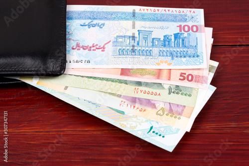 Fototapeta  Iranian money - Rial in the black wallet