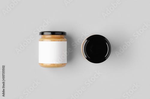 Fotografering Peanut, almond, nut butter jar mockup with blank label.