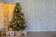 Leinwanddruck Bild Christmas and new year background - christmas tree, heap of gifts, folding screen with lights and copy space