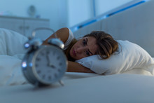 Woman With Insomnia Lying In B...