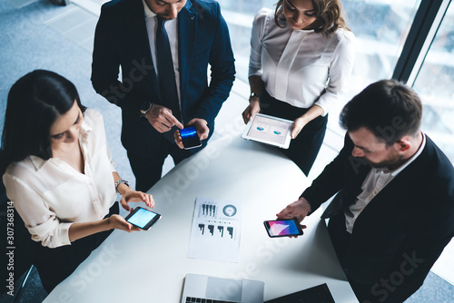 Fototapeta Group of office workers using devices in conference room obraz