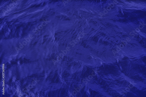 Closeup of calm river water surface with water splashes in trendy dark blue color. Ideal river, sea and ocean texture. Trendy fresh abstract nature background.
