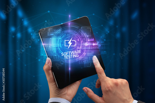 Businessman holding a foldable smartphone with SCIENCE inscription, new technology concept SOFTWARE TESTING
