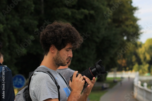 photographer amateur profile portrait with camera in street walking time in park Wallpaper Mural