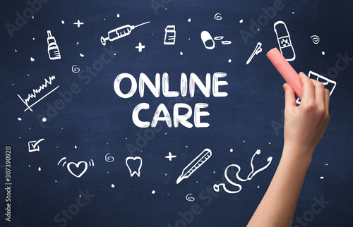 Hand drawing ONLINE CARE inscription with white chalk on blackboard, medical concept