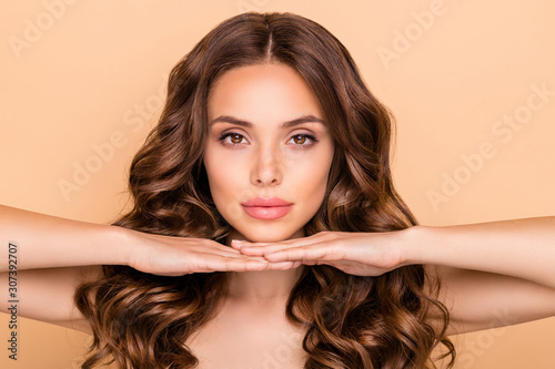 Fototapeta Close-up portrait of her she nice-looking attractive gorgeous well-groomed sweet tender confident wavy-haired girl showing enhancement effect isolated over beige pastel color background obraz