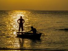 Maldivian Fishermen At Sunset In The Atoll Of Ukulhas