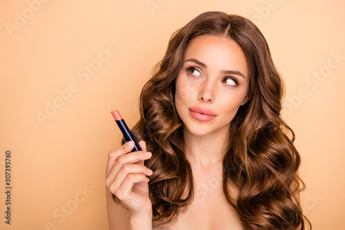 Close up photo of charming girl hold pomade try check think about new shine effe Canvas Print