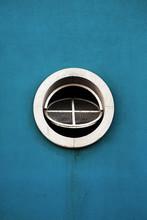 Round Window On Blue Wall. Minimal. Minimalism. Circle. Circular