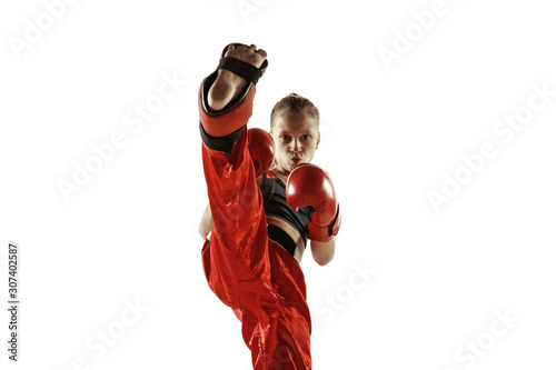 Young female kickboxing fighter training isolated on white background фототапет